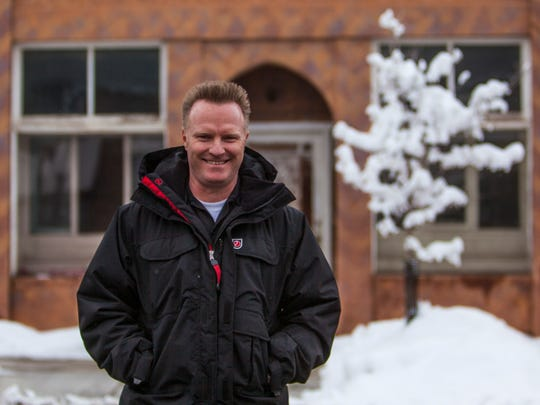 Jason Green stands in front of his new building in