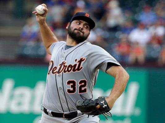FILE - In this Aug. 14, 2017, file photo, Detroit Tigers starting pitcher Michael Fulmer throws to the Texas Rangers in the first inning of a baseball game in Arlington, Texas. Tigers general manager Al Avila says right-hander Michael Fulmer is expected to be at full strength at spring training. (AP Photo/Tony Gutierrez, File)