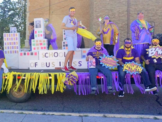 The School of Business had a super hero float with