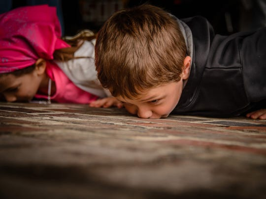 Lots of visitors to the Indianapolis Motor Speedway want to experience the tradition of kissing the bricks.