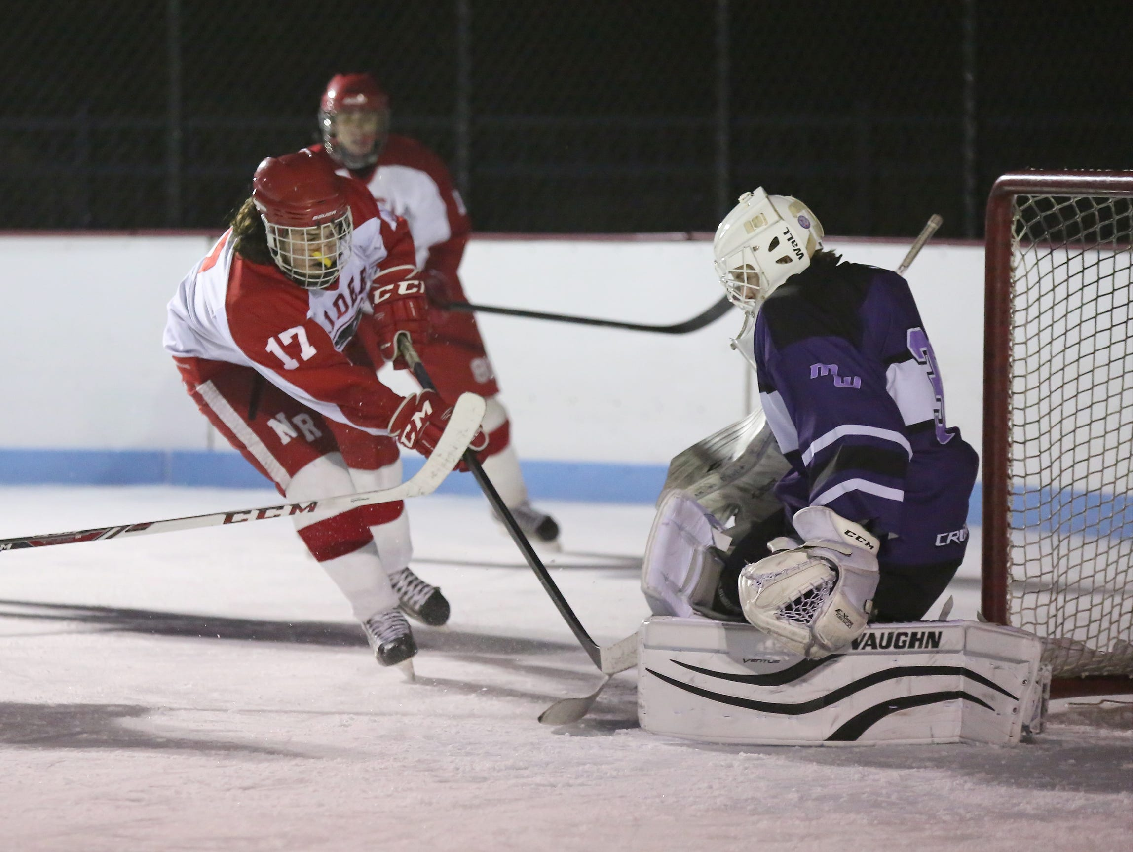 North Rockland's Charles Lowther (17) scores on Monroe-Woodbury goalie Dan Dorney during the first annual Winter Classic Hockey Tournament at the Bear Mountain Ice Rink in Tompkins Cove on Friday, Dec. 18, 2015.