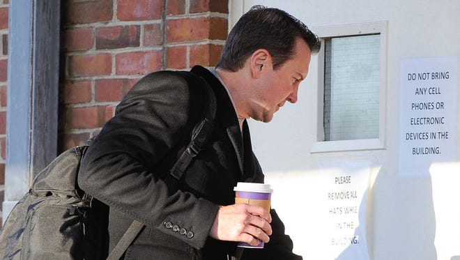 Kurt Busch arrives for his protective order hearing at Kent County Family Court on Tuesday.