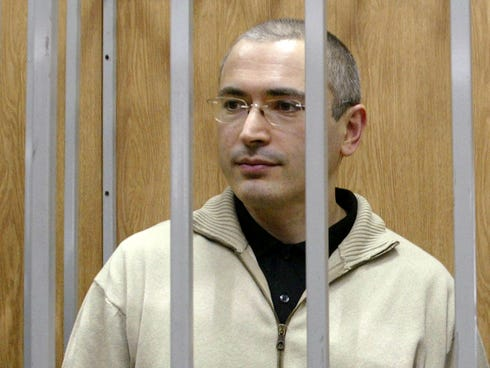 Mikhail Khodorkovsky listens to a judge from behind bars at a courtroom in Moscow, Russia, in 2004.