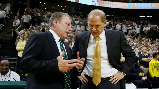 Michigan State coach Tom Izzo, left, and Michigan coach John Beilein will face each other at least twice a year under the Big Ten's new 20-game scheduling plan, which begins with the 2018-19 season.