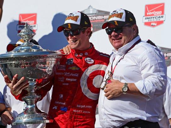 Chip Ganassi, right, celebrates with driver Scott Dixon