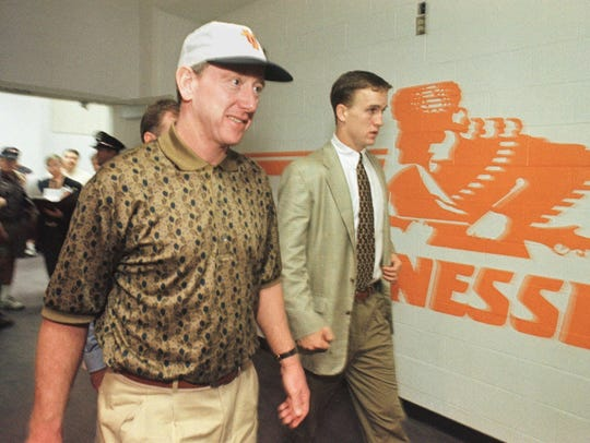 Archie Manning walked with son Peyton after a game