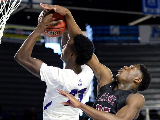 Memphis East center Malcolm Dandridge, right, fouls Southwind forward Kameron Jones (23) during the first half of the Tennessee Division I AAA boys' high school basketball championship game Saturday, March 18, 2017, in Nashville, Tenn. (AP Photo/Mark Zaleski)