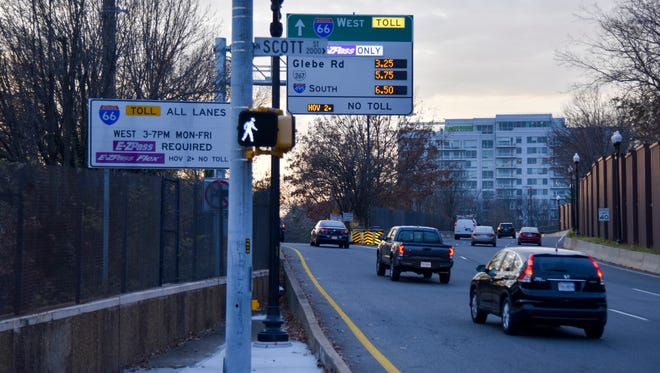 Interstate 66 toll lanes opened Monday in Washington's northern Virginia suburbs. Here cars in Arlington, Va., head toward the new lanes.