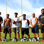 From left, Southside High School center Taurus Skonic, linebacker and running back Will Houston, wide receiver Tuzion Brock, defensive lineman Dre Mills, defensive end Anthony Smith and defensive tackle Nevin Turner.