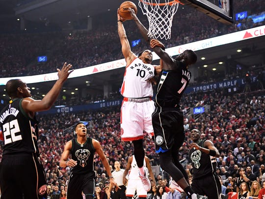 Bucks center Thon Maker blocks a shot by Raptors guard DeMar DeRozan in the first half of Milwaukee's victory over Toronto on Saturday at the Air Canada Centre.