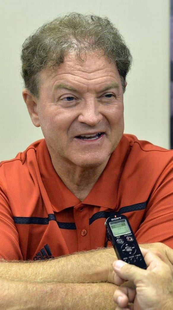 Auburn has hired Greg Brown, who in his photo is being
