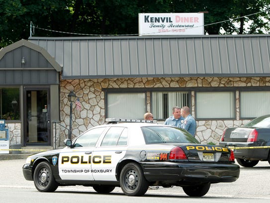 Police at the Kenvil Diner in Roxbury on Sunday, May