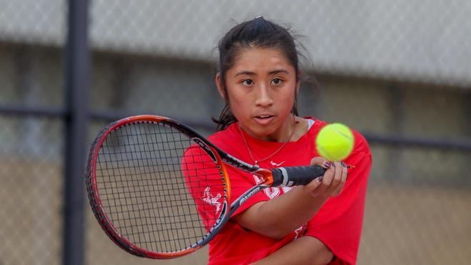 East Providence's No. 1, Raissa Luu, returns a shot during her match against Providence Country Day on Friday afternoon, the first day of fall high school sports.