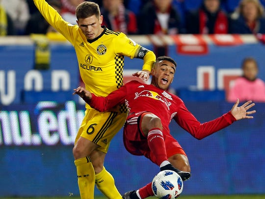 New York Red Bulls midfielder Tyler Adams battles for the ball with Columbus Crew midfielder Will Trapp during the first half of a soccer game on Nov. 11 in Harrison, N.J.