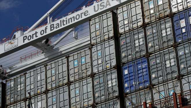 In this Oct. 24, 2016, photo, a crane hangs over a container ship at the Port of Baltimore in Baltimore. On Friday, Aug. 4, 2017, the Commerce Department reports on the U.S. trade gap for June. (AP Photo/Patrick Semansky) ORG XMIT: NYBZ503