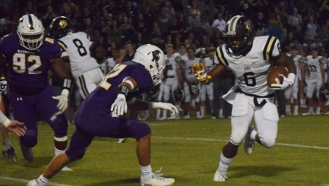 Jena running back Trelon Jones (6) runs for a gain against ASH Friday, Sept. 28, 2018.