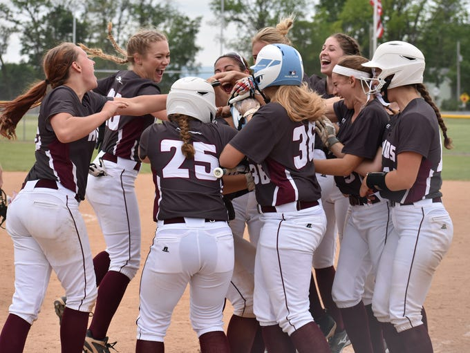 The Shippensburg softball team celebrates after Courtney
