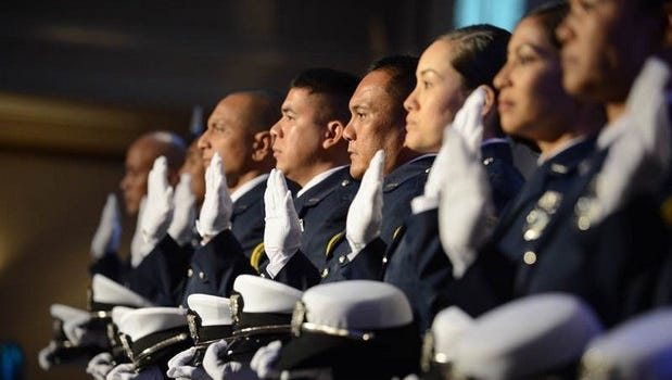 This file photos shows some of those who completed the Guam Custom and Quarantine Agency's 10th training academy being sworn in as new customs officers.