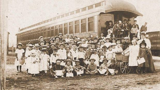 Homeless children wait to board a train to the western United States in this photo from early in the 20th century. Don Youniss gives a program on this practice during the April 14 meeting of the Kewaunee County Historical Society.
