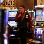 Slot attendant Chad Rogers works the floor at Horseshoe Casino Cincinnati, which has almost 400 fewer jobs than when it opened.