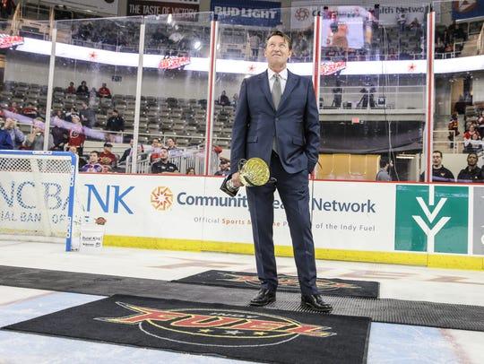Wayne Gretzky prepares to award youth hockey trophies