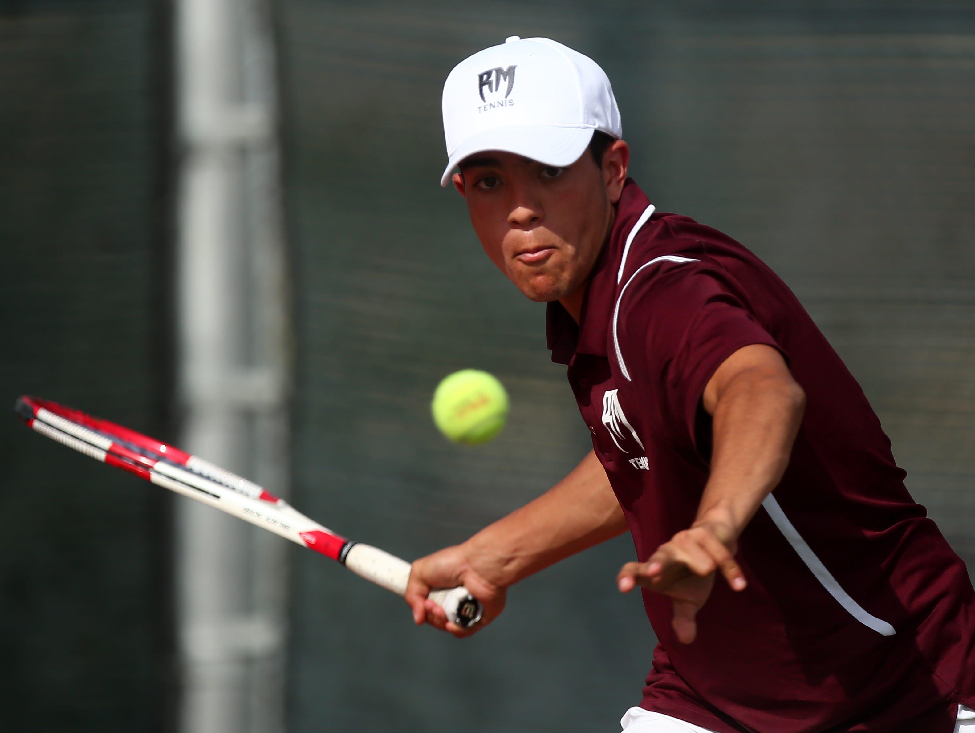 Ismael Cuevas of Rancho Mirage High School returns the ball to John Lanza of Twentynine Palms High School during a tennis match Wednesday, April 6, 2016, in Rancho Mirage, Calif.