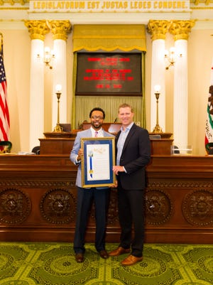 SafeHouse of the Desert Program Director Shawn Johnson received the California Nonprofit of the Year award from Assemblyman Chad Mayes at a June 22, 2016 ceremony.