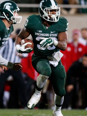 Michigan State's Jeremy Langford rushes against Nebraska during the fourth quarter of an NCAA college football game, Saturday, Oct. 4, 2014, in East Lansing, Mich. Michigan State won 27-22. (AP Photo/Al Goldis)