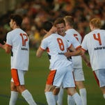Michigan Bucks player Spencer Thompson (8) is hugged by teammate Kevin Taylor wihle celebrating Thompson's goal over Detroit City FC on Wednesday at Ultimate Soccer Arena in Pontiac during the U.S. Open Cup opener.