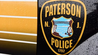 Paterson police logo on vehicle.