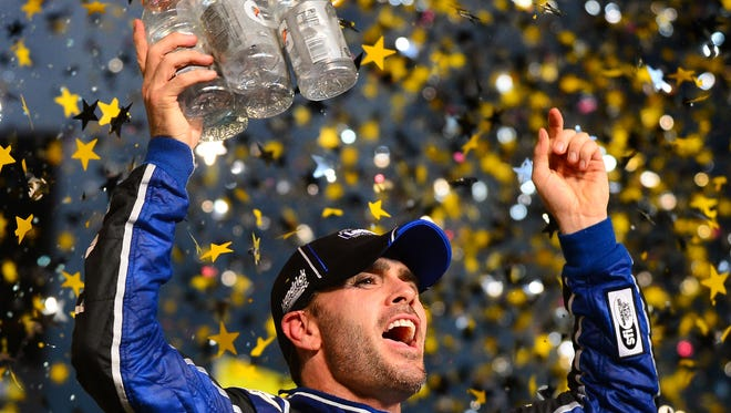 Sprint Cup Series driver Jimmie Johnson celebrates in victory lane after winning the Sprint Cup championship after the Ford EcoBoost 400 at Homestead-Miami Speedway.