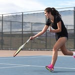 Fort Collins High School's Taylor Campos is one of more than 30 Fort Collins-area girls tennis players qualified for the state tournament. The tournament has been postponed and moved to Monday through Wednesday of next week.