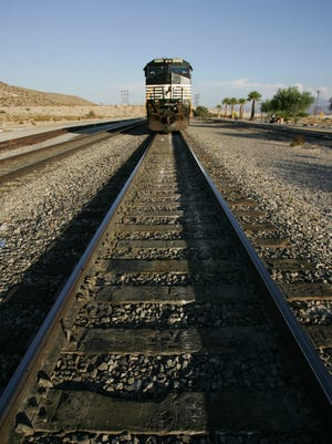 A west-bound 74-car Union Pacific freight train is stopped on the tracks at the Palm Springs Amtrak Station in 2006.