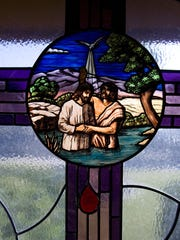 A stained glass window at the First Southern Baptist Church in St. George depicts the baptism of Jesus.