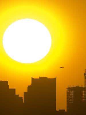Sun behind the Phoenix skyline
