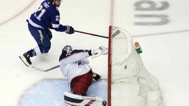 Lightning forward Brayden Point flips the puck past goaltender Joonas Korpisalo for a goal 5 minutes, 12 seconds into overtime that ends the Blue Jackets' season Wednesday in Toronto.