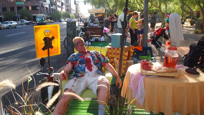 One year during Park(ing) Day, a zombie took over a metered parking space.