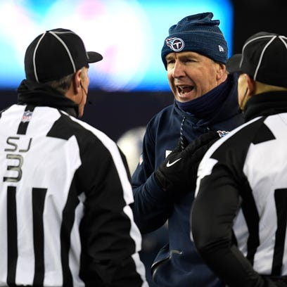 Titans head coach Mike Mularkey argues with referees