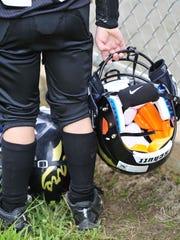 A Mt. Juliet Bears player holds his helmet.
