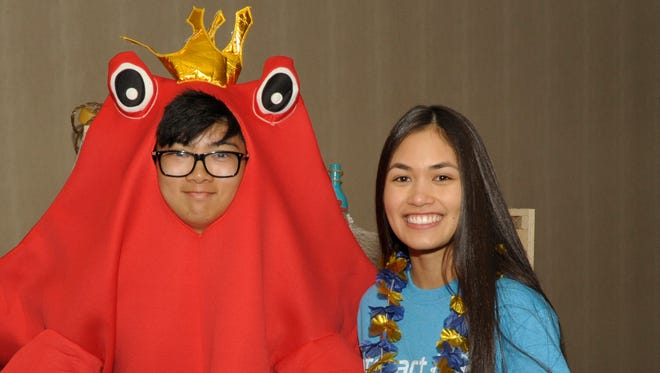 Jeremiah Ramos, 17, left, and Megan Person, 17, attend the 19th Annual Reno Crab Feed hosted by the Reno Central Rotary at the Grand Sierra Resort on Saturday, April 21, 2018.