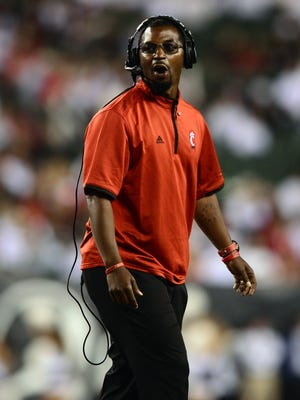 Sep 12, 2014; Cincinnati, OH, USA;  Cincinnati Bearcats cornerbacks coach Steve Clinkscale on the sidelines against the Toledo Rockets at Paul Brown Stadium.