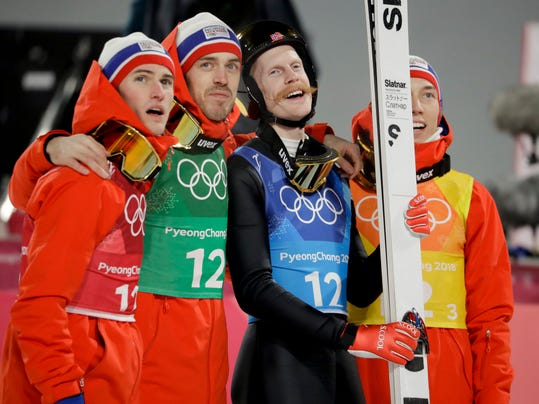Norway's Daniel Andre Tande, from left, Andreas Stjernen, Robert Johansson and Johann Andre Forfang celebrate after winning the gold medal in the men's large hill team ski jumping competition at the 2018 Winter Olympics in Pyeongchang, South Korea, Monday, Feb. 19, 2018. (AP Photo/Matthias Schrader)