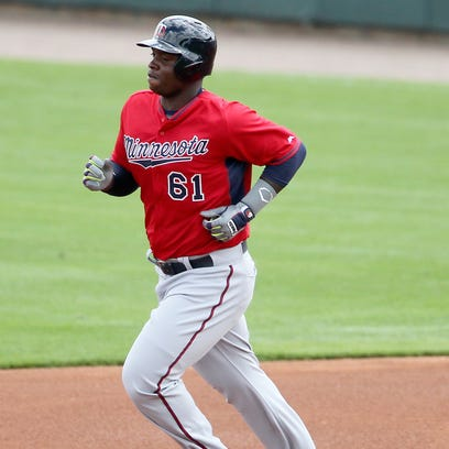 Mar 9, 2015; Bradenton, FL, USA; Minnesota Twins third baseman Miguel Sano (61) rounds the bases after a solo home run during the second inning of a spring training baseball game at McKechnie Field. Mandatory Credit: Reinhold Matay-USA TODAY Sports