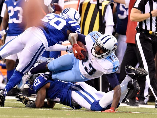Titans wide receiver Kendall Wright (13) gains yards