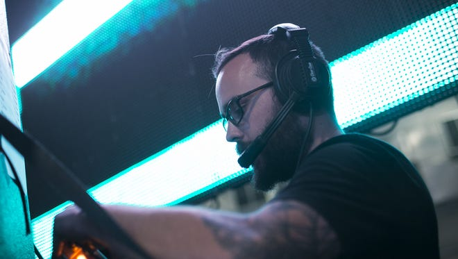 """Austin Perkins, with PK music and Relentless Beats, prepares for the """"Boo!"""" festival at Rawhide Event Center in Chandler on Oct. 15 2016."""
