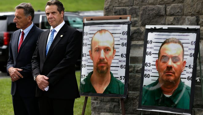 On Wednesday, June 10, 2015, Vermont Gov. Peter Shumlin (left) and New York Gov. Andrew Cuomo listen during a news conference in front of the Clinton Correctional Facility in Dannemora, N.Y., where inmates David Sweat and Richard Matt escaped using power tools.