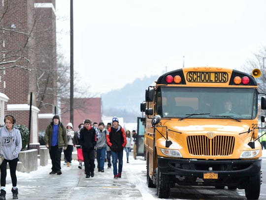 Students get off the school bus at Union Endicott High