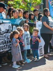 Children of members of Migrant Justice listen during a news conference where the farm workers rights organization and Ben & Jerry's ice cream announced an agreement in Burlington on Tuesday, October 3, 2017. The Milk with Dignity program seeks to ensure that milk provided to the ice cream maker is produced under fair working conditions.