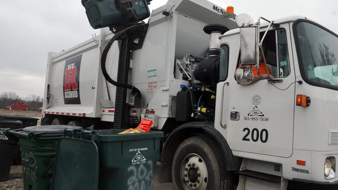 A Richmond Sanitary District worker picks up Rosie Rollers on his trash route.