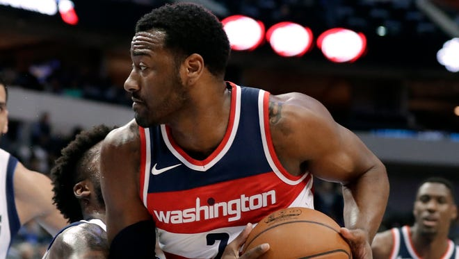The Wizards' John Wall had words with Dallas' J.J. Barea.